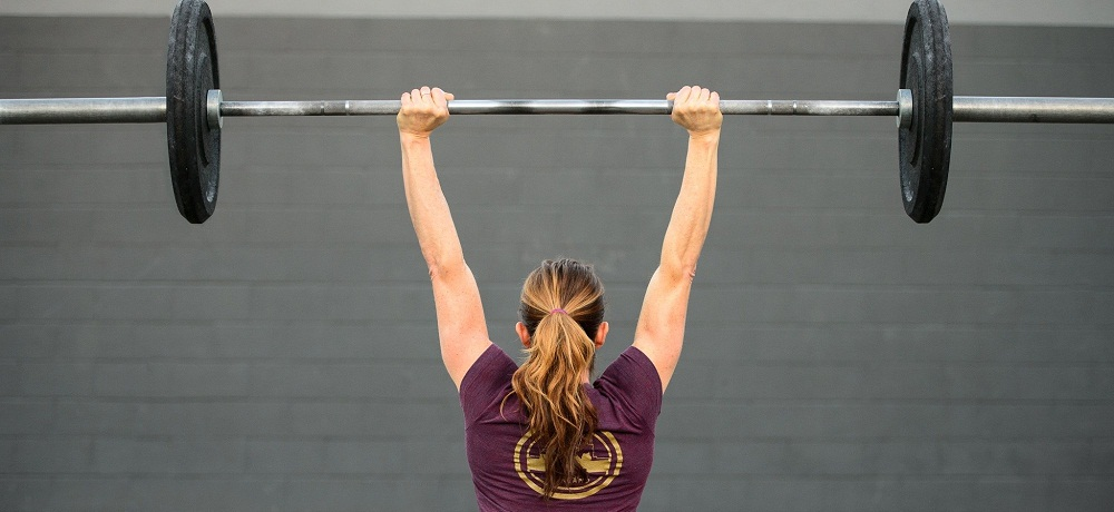 5 Barbell Exercises to Build Muscle, Power and Strength ... Dumbbell Overhead Press