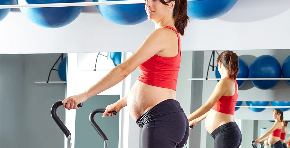 pregnant woman pilates tendon stretch exercise