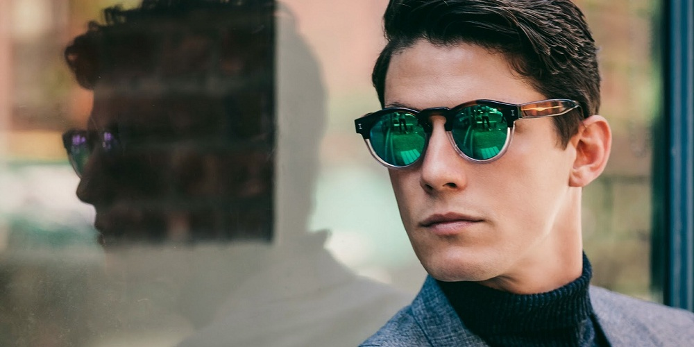 men wearing green sunglasses