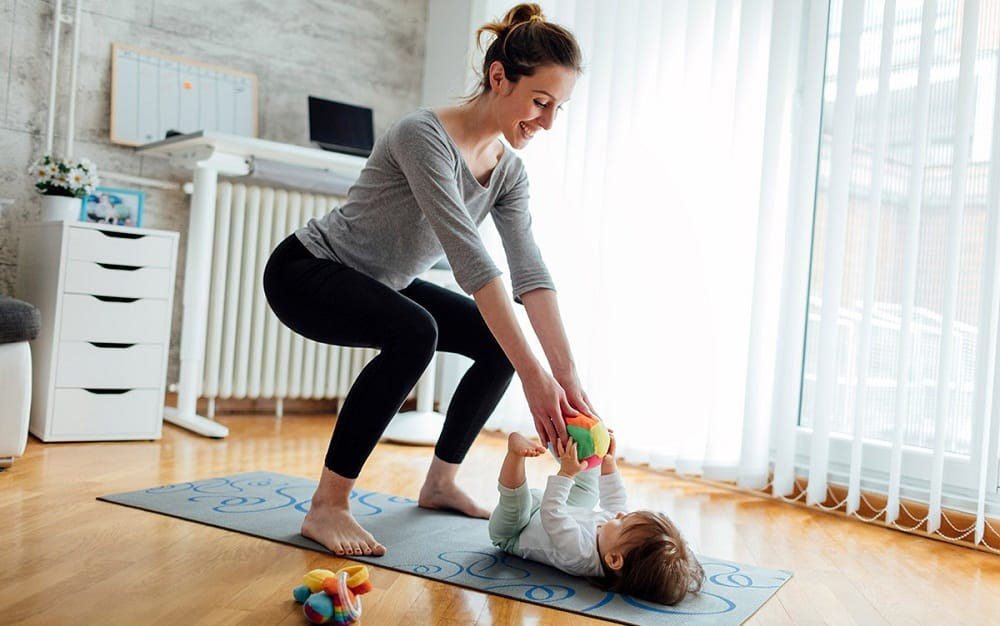 mom-working-out-in-home-with-baby